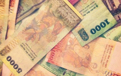 Sri Lankan Rupee Holds Steady Near Record Low