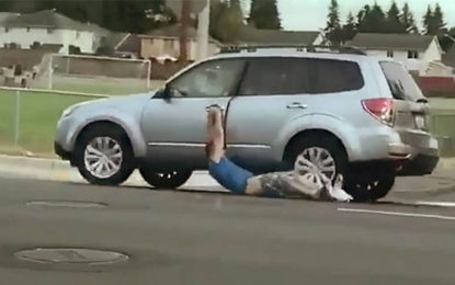 Washington Kent City Car Robber Dragged to the Police Naked