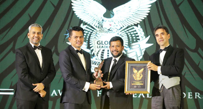 Minister Rishad Bathiudeen wins Global Leadership Award in Malaysia