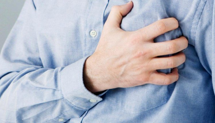 Adhesive patch to reduce heart attack damage