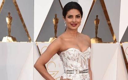 Priyanka Chopra Shines in White on Red Carpet in Oscars 2016