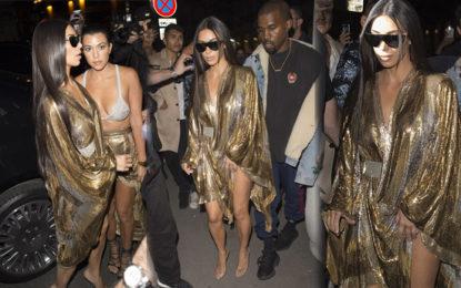 Kim Kardashian and Sister Kourtney Match in Skimpy Metallic Outfits