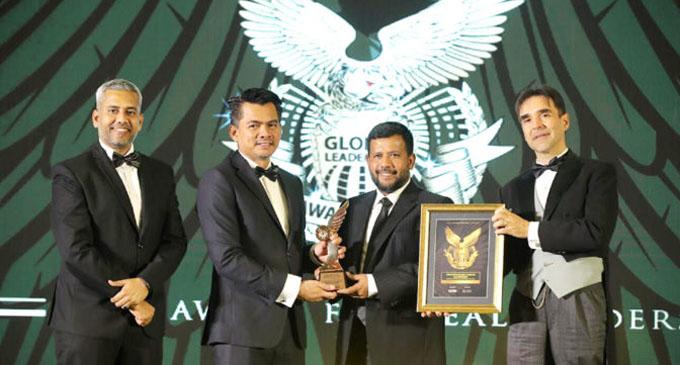 Minister Rishad Bathiudeen wins Global Leadership Award in Malaysia