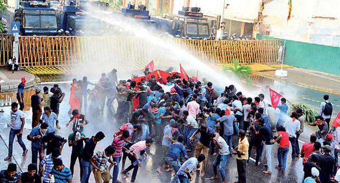 Police fire tear gas and water cannons to disperse University students