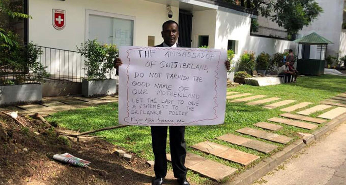 "Protestor urges ""Kidnapped"" Swiss Embassy worker to give statement"