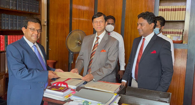 State Minister Cabraal hands over his resignation letter